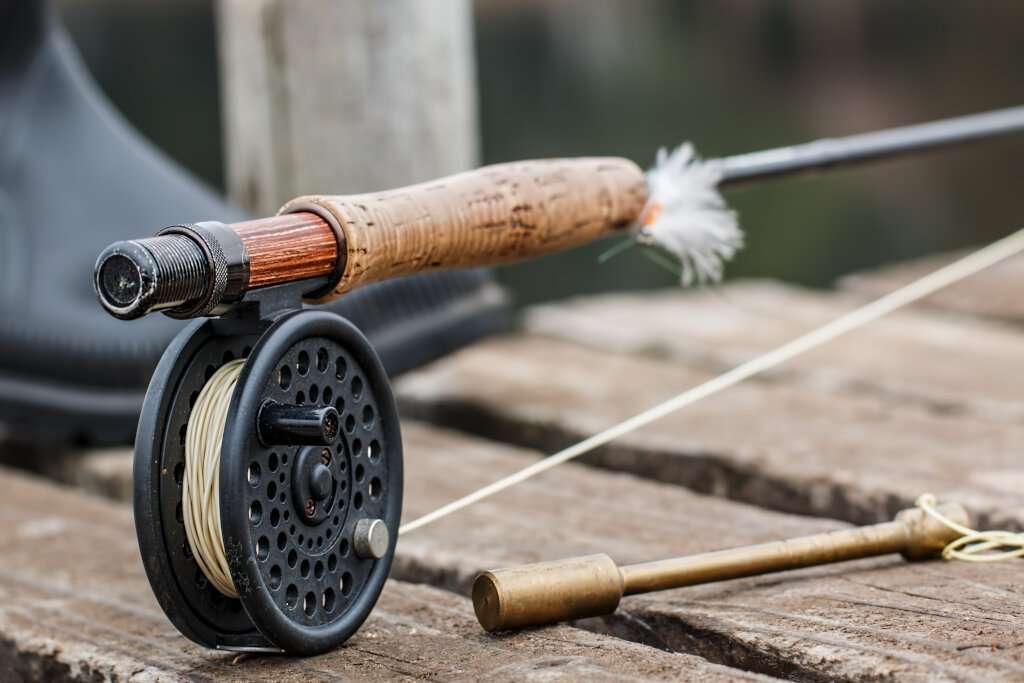 Fly Fishing rod on wooden jeti at lochend